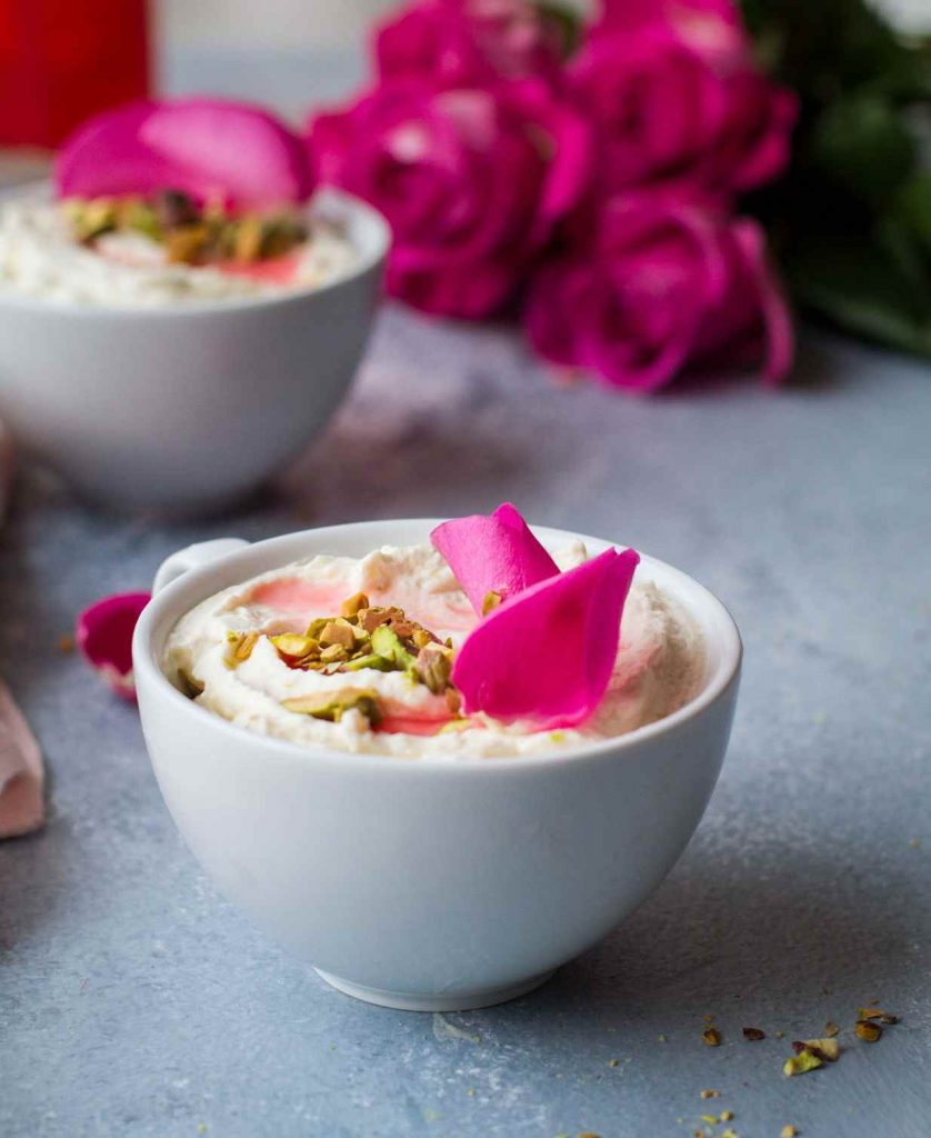 White Chocolate mousse with rose petals and pistachios.
