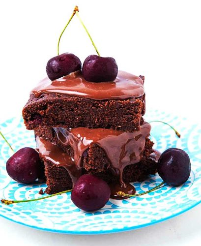 Chocolate brownies with cherries.