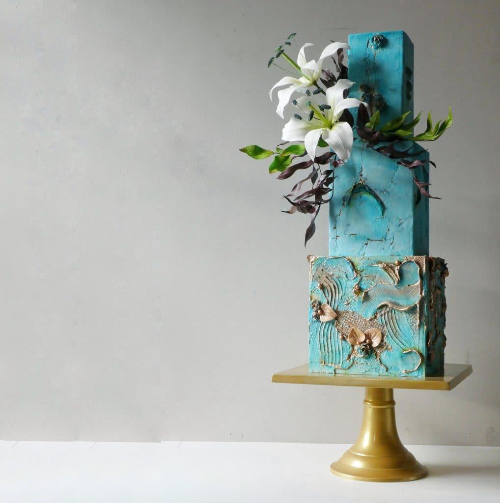 blue cube-shaped textured wedding cake.